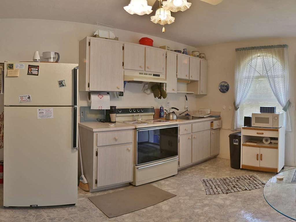 Kitchen 1 apartment immobilien florida kaufen for Innendekorateur berufsbild